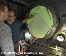 Terry Giesige inspects a ball punch with Phygen FortiPhy PVD Coating